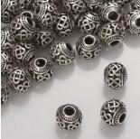 Zdjęcie - Koralik z ciemnego srebra z wyciętymi zawijasami